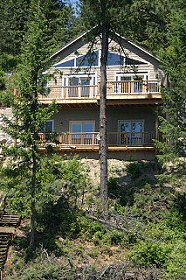The lake side of the house has decks on both levels and windows galore! Hayden Lake House Vacation Rental, Hayden Lake, Idaho