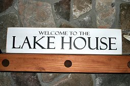 The lake sign on the fireplace mantle. Hayden Lake House Vacation Rental, Hayden Lake, Idaho
