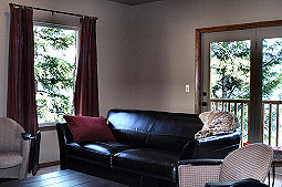 Relax on the comfortable seating while enjoying the impressive views! Hayden Lake House Vacation Rental, Hayden Lake, Idaho