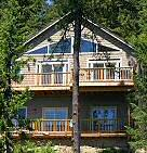 The Lake House on Hayden rests right on the lake, with 2100 square feet of living space, multiple view decks, a large private dock, and all the comforts of a 5-star hotel! Hayden Lake House Vacation House Rental, Hayden Lake, Idaho